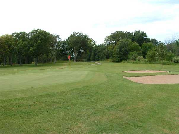 A view of green with bunker on the right side at Old Hickory Country Club