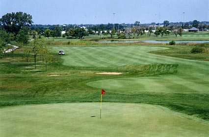 A view of the 8th green and fairway at Odyssey Golf Course