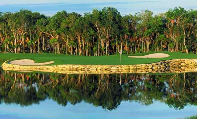 A view over the water of a green protected by bunkers at Moon Palace Cancun.