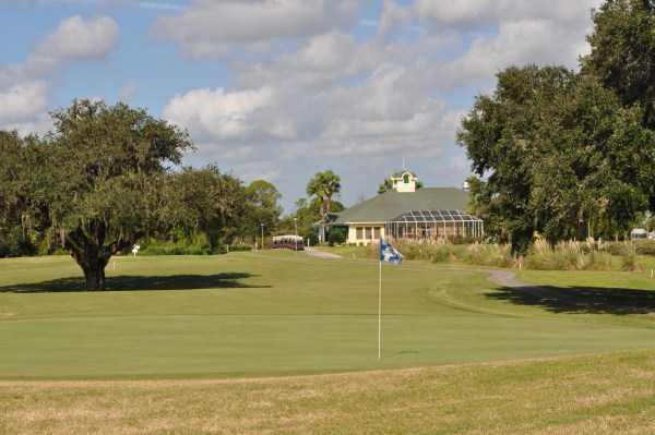 A view of a green with the clubhouse in background at Pennbrooke Fairways