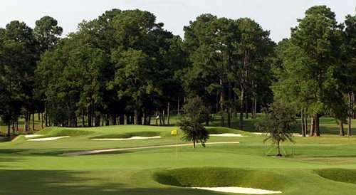 A view of greens protected by sand traps at Cape Fear Country Club