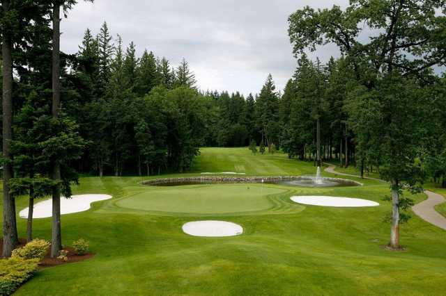 A view from the clubhouse of green protected by bunkers at Camas Meadows Golf Club