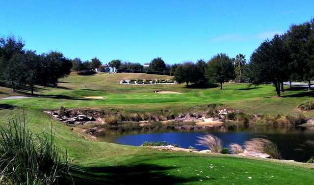 A view over the pond of a green at Legends Golf & Country Club