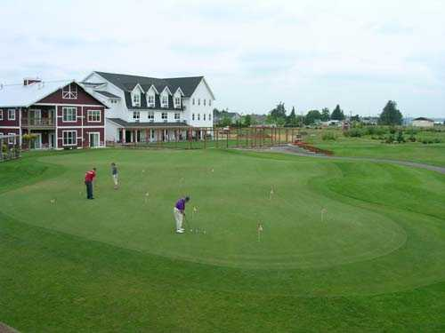 A view of the practice putting green at Homestead Farms Golf Club