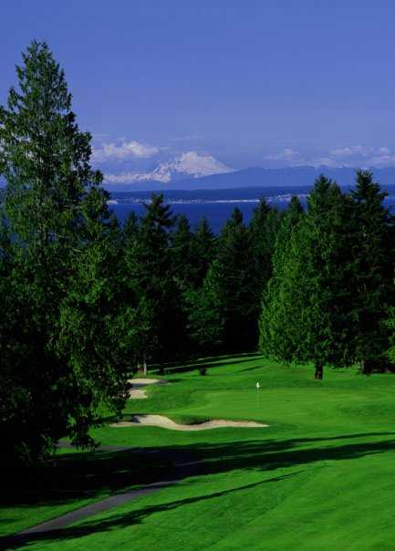 A view of a hole with sand traps on the left at Port Ludlow Resort