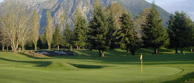 A view of green #18 with mountain in background at Mt. Si Golf Course.