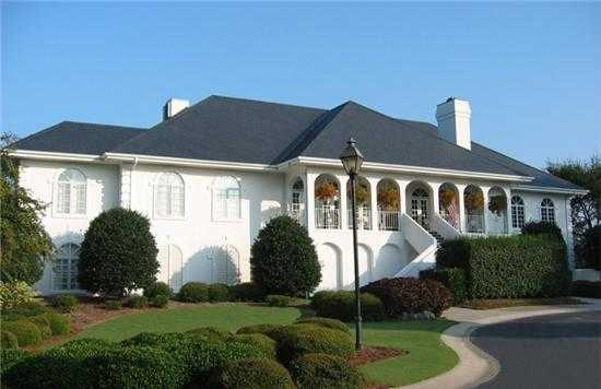 A view of the clubhouse entrance at Pete Dye Course from Country Club of Landfall