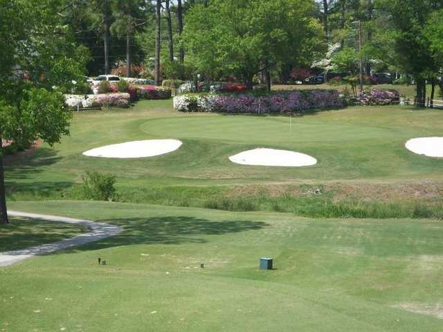 A view of green protected by bunkers at Pine Valley Country Club
