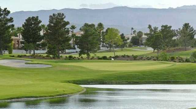 A view of a green with water coming into play at Spanish Trail Country Club