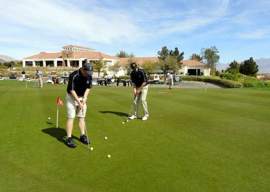 A view of the practice area and the clubhouse at Highland Falls Course from Golf Summerlin