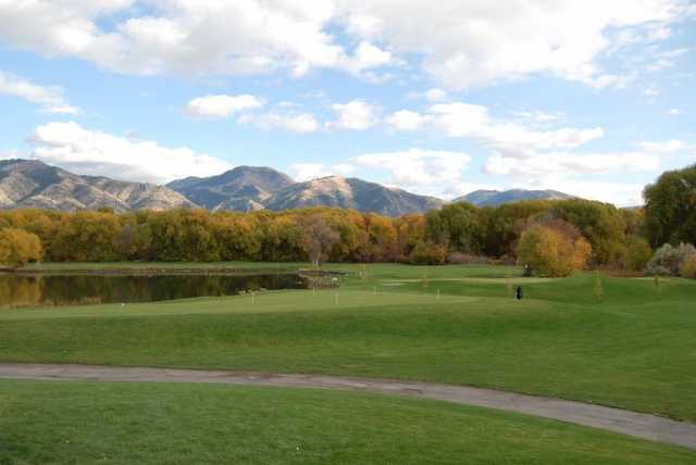 A fall view of the practice area with mountains in backgrouns at Logan River Golf Course