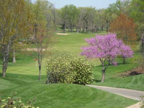 A view of the 9th green from the putting green at Deer Creek Golf Club