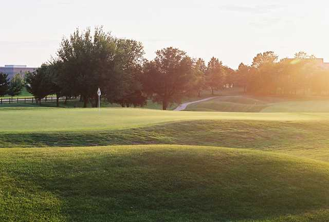 A sunny view of green #1 at Deer Creek Golf Club