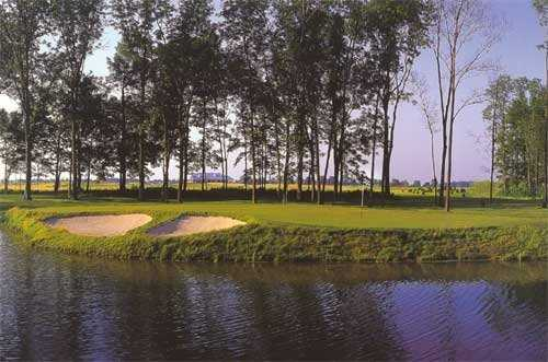 A view over the water of hole #2 at The Links at Heartland Crossing