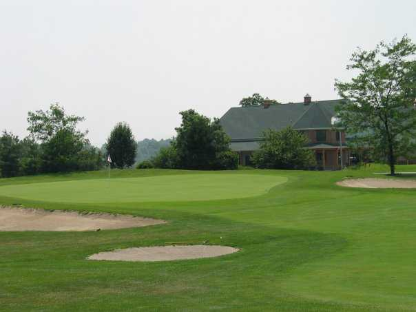 A view of green surrounded by sand traps at Deer Creek Golf Club