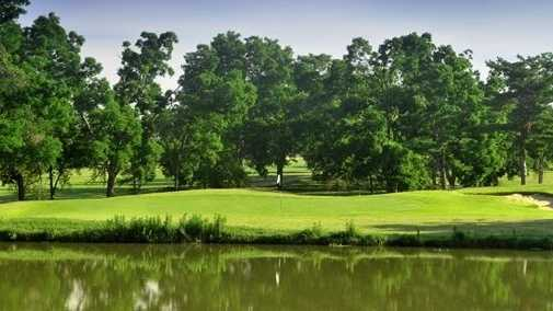 A view over the water of a hole at Olde Page from Page Belcher Golf Course