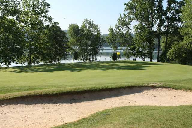 A view of green with water in background at Pine Ridge Golf Course