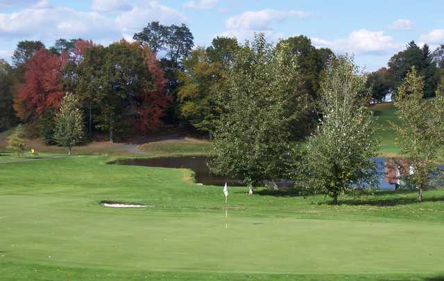 A view of green with water in background at Portland Golf Course West