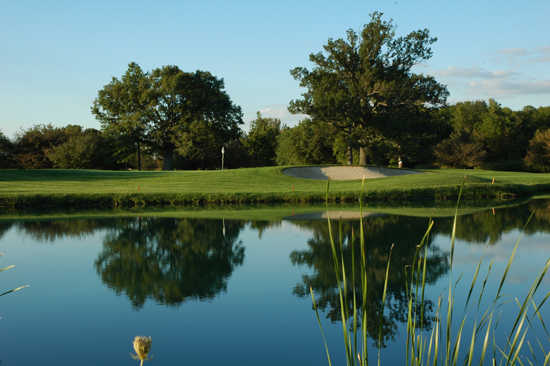 A view over the water of green at Golf Club of Indiana