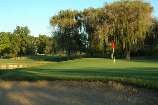 A view of a hole protected by sand trap at Golf Club of Indiana