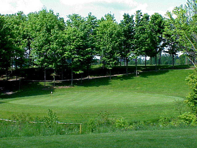 View of the 16th green at Sunset Ridge Golf Club