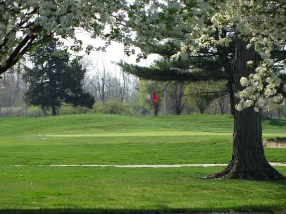 A spring view of a green at Sahm Golf Course