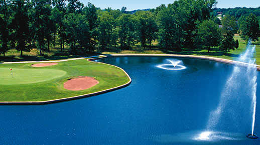 A view of a hole with water coming into play at Christmas Lake Golf Course