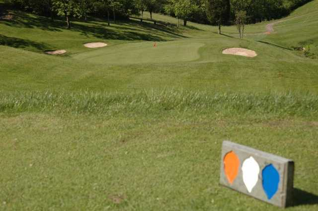 A view of a hole guarded by bunkers at Grand Oak Golf Club