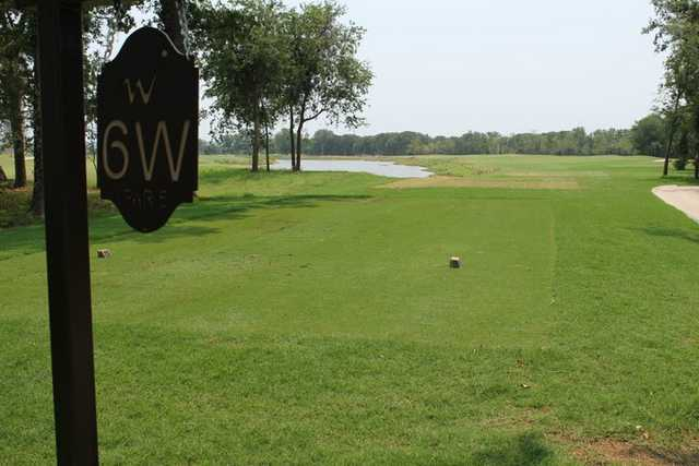 A sunny day view of a tee from RedBud at WinStar Golf Course.