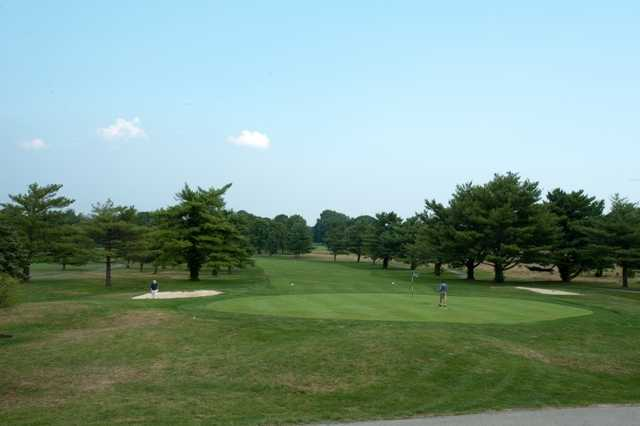 A view of a green and a fairway at Ed Oliver Golf Club