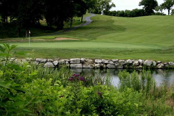 A view over the water of a hole at Adams Pointe Golf Club