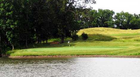 A view over the water of green at Hail Ridge Golf Course