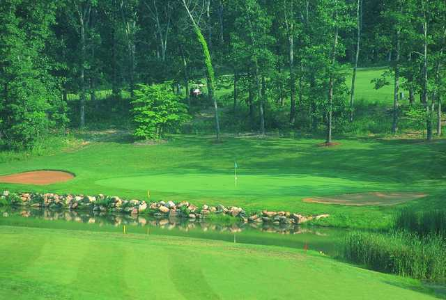 A view of a hole protected by sand traps at Indian Rock Golf Club