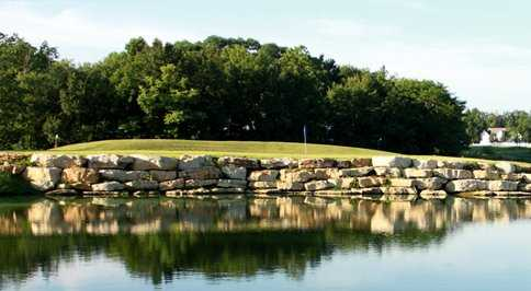 A view of a hole surrounded by water at Woods Fort Country Club