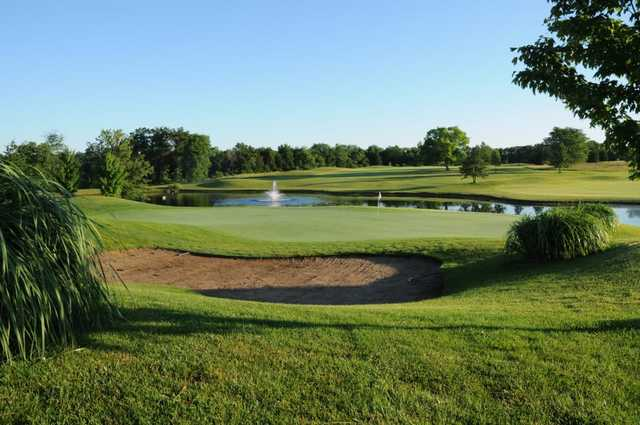 A view of a hole with water fountain in background at Golf Club Of Wentzville