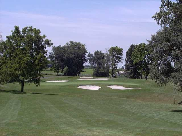 A view of the 8th green protected by sand traps at Mercer County Elks Country Club