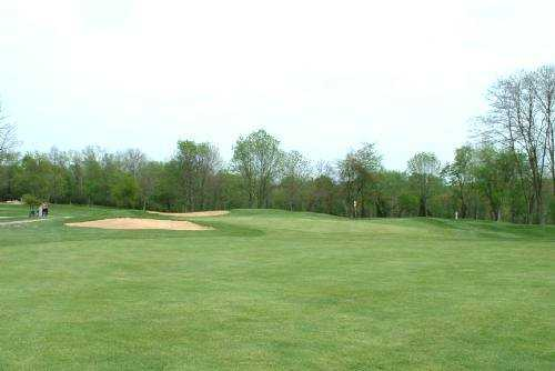 A view of the 7th green protected by sand traps at Beech Creek Golf Course