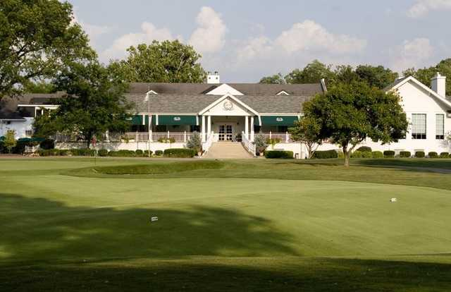 A view of the clubhouse and hole #18 at Hyde Park Golf & Country Club