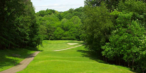 A view of green protected by sand traps at Sharon Woods Golf Course