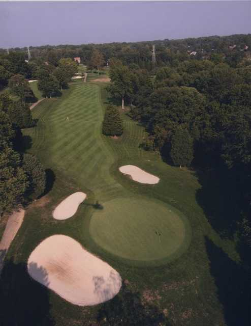 Aerial view of green protected by bunkers at Stillmeadow Country Club
