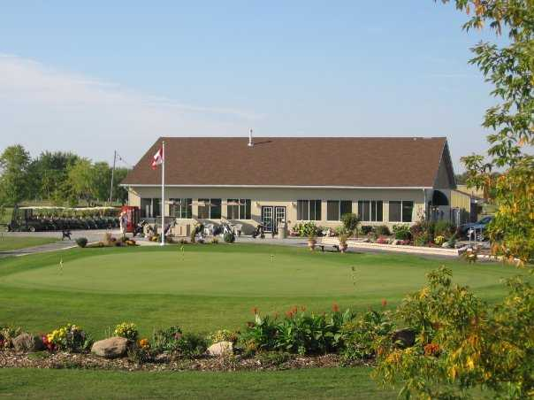 A view of the clubhouse and practice putting green at Landings Golf Course