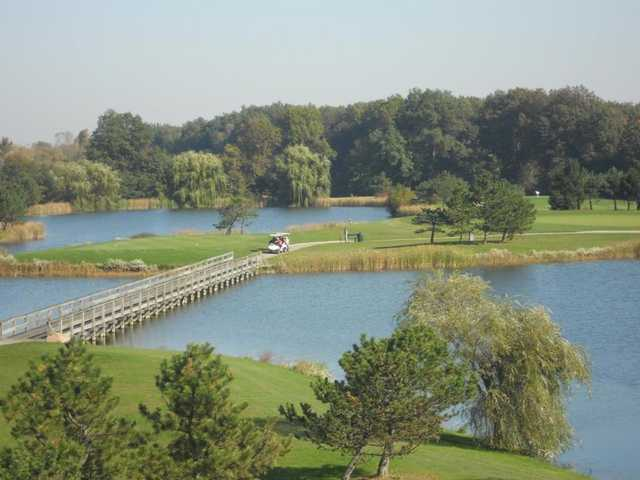 A view from Mallard Creek Golf Club with a bridge on the left side