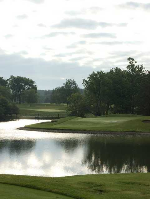 A view of a green surrounded by water at Hawthorne Hills Golf Course
