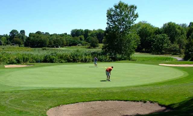 A view of a hole protected by sand traps at The Sanctuary Golf Club