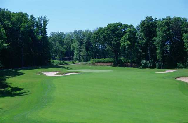 A view of a hole protected by bunkers at Quail Hollow Country Club.