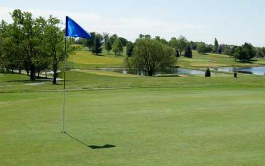 A sunny view of a hole at Lone Oak Golf Course