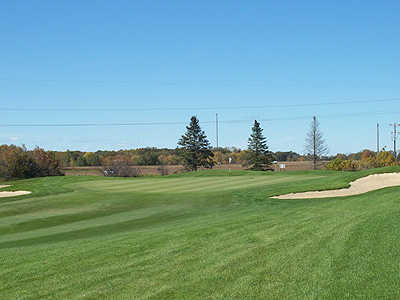 A view of the 17th hole flanked by bunkers at Bulrush Golf Club