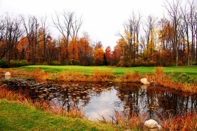 A fall view over the water of green from Warren Golf Course At Notre Dame