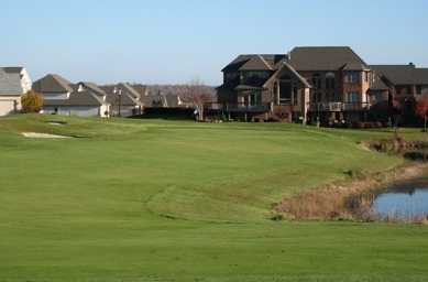 A view of the 18th hole and clubhouse at Roses Run Country Club