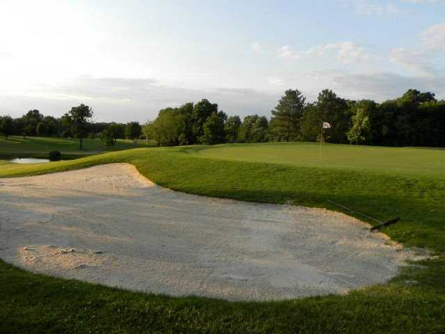 A view of green protected by bunker at Fox Den Golf Course